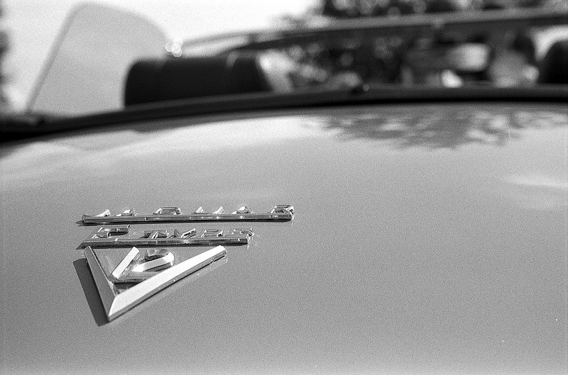 E-Type V12 badge in black and white
