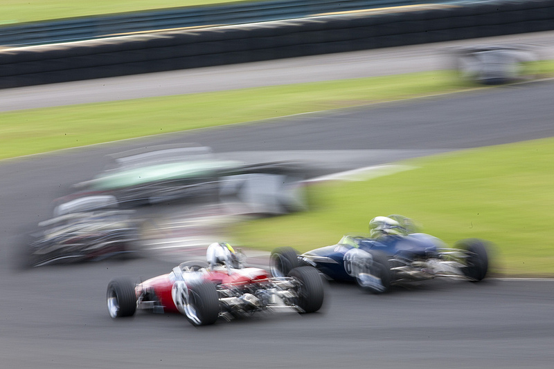 Formula 3 cars racing at Croft, photographed in a blurred fashion