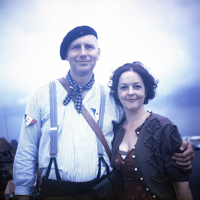 A couple dressed in WW2 style clothing