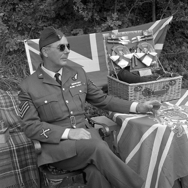A man in RAF uniform enjoying a picnic at Crich Tramway 1940s weekend - Fine Art Photography