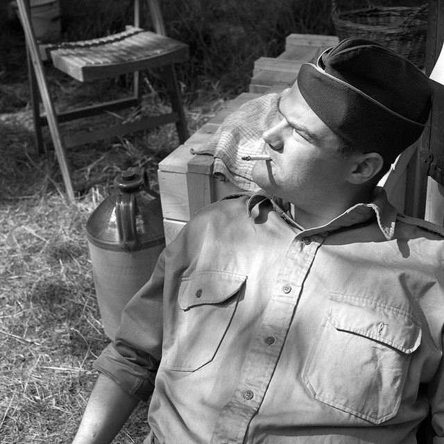 A soldier smoking at Crich Tramway 1940s weekend - Fine Art Photography