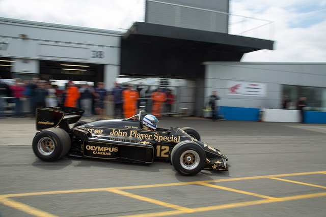 Senna's Lotus heads out of the pits