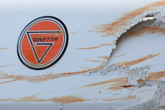 Ginetta bumber with grazes - motorsport photography