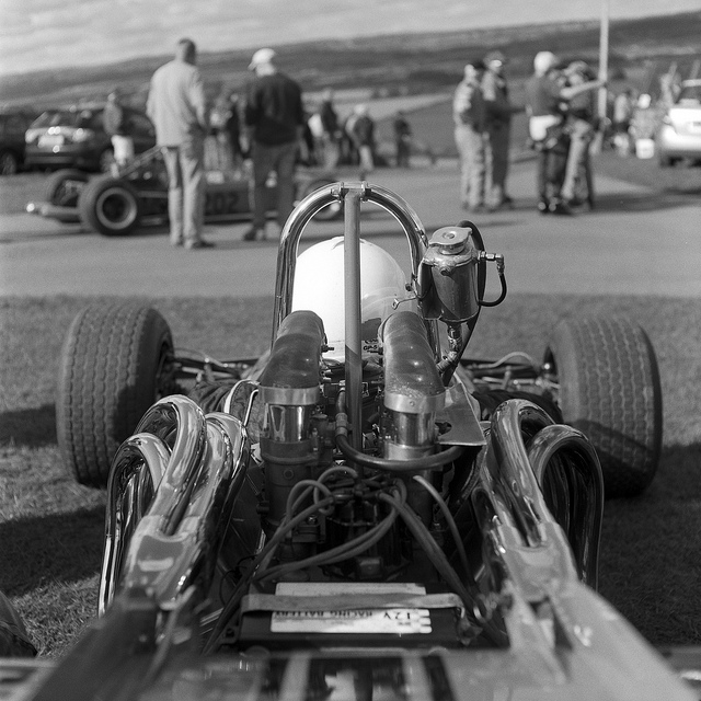 Black and white photograph of a classic single seater at Harewood Hillclimb