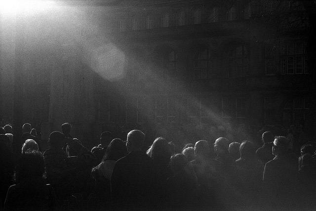 Light spilling over the Cenotaph onto the crowd