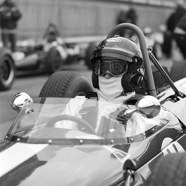 Portrait of John Romano in the Brabham BT11 at Silverstone