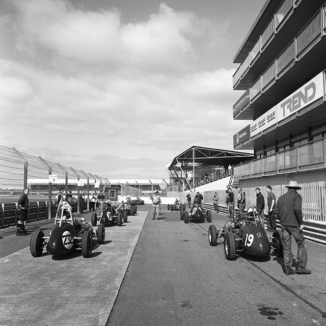 Front engined grand prix cars wait to go out on track at Silverstone.
