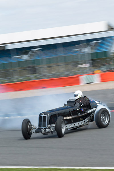 J M Hulbert's ERA flying off the track backwards after spinning through Copse corner at Silverstone.