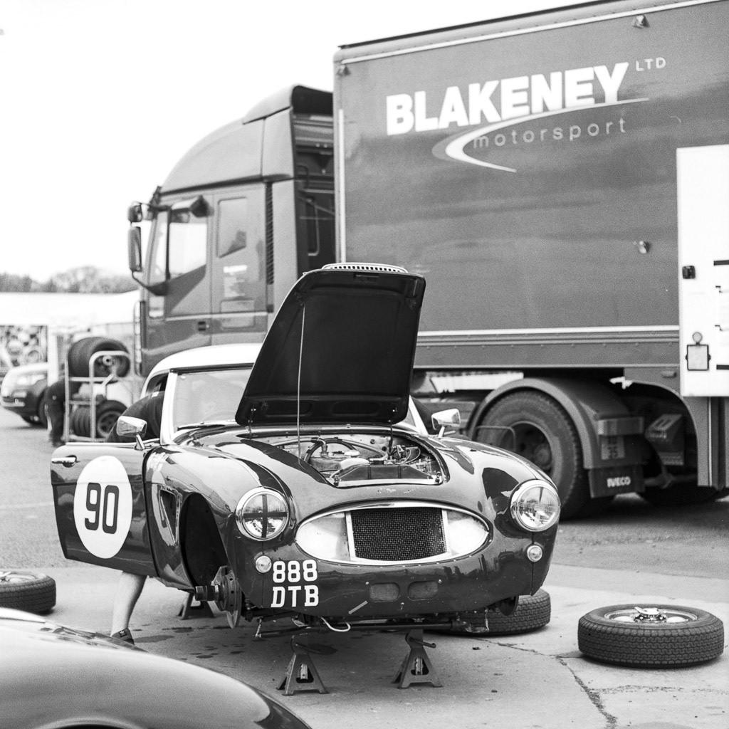 Steve Boultbee Brooks nad  Robert Beebee's Austin Healey in front of a Blakeney Motorsport truck at Donington Park
