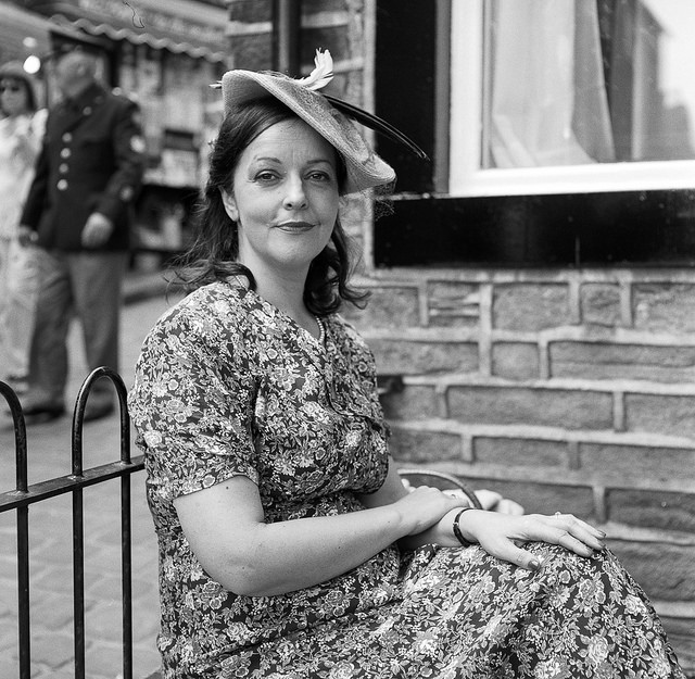 Lady in flowery dress at Haworth 1940s event.