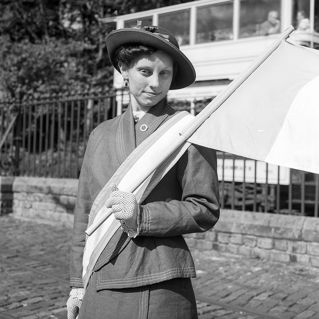 A suffragette holding a flag at the Crich Tramway Edwardian Weekend