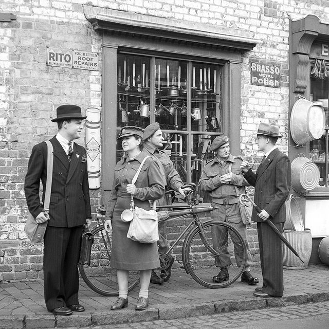 Re-enactors outside an ironmongers creating a street scene at the Black Country Museum.