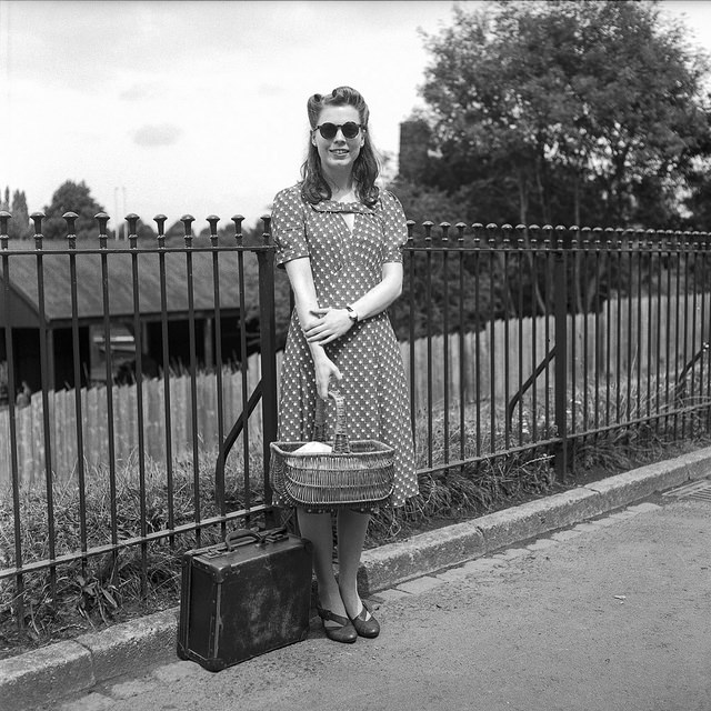A lady in a lovely pattern dress, complete with sunglasses, victory rolls and picnic basket. A full length shot produced a classy, timeless image.