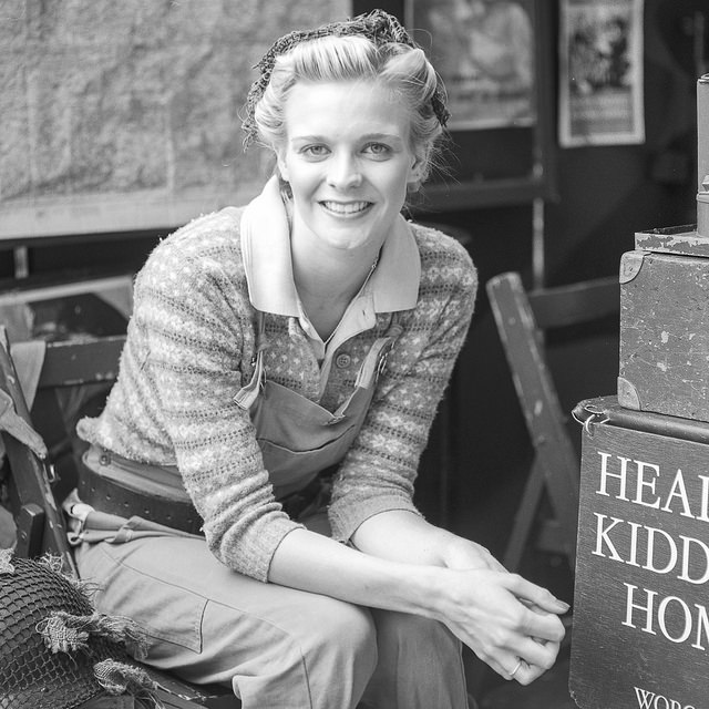 Fine art photography - a lady dressed in land army clothing smiling at the Crich Tramway 1940s event