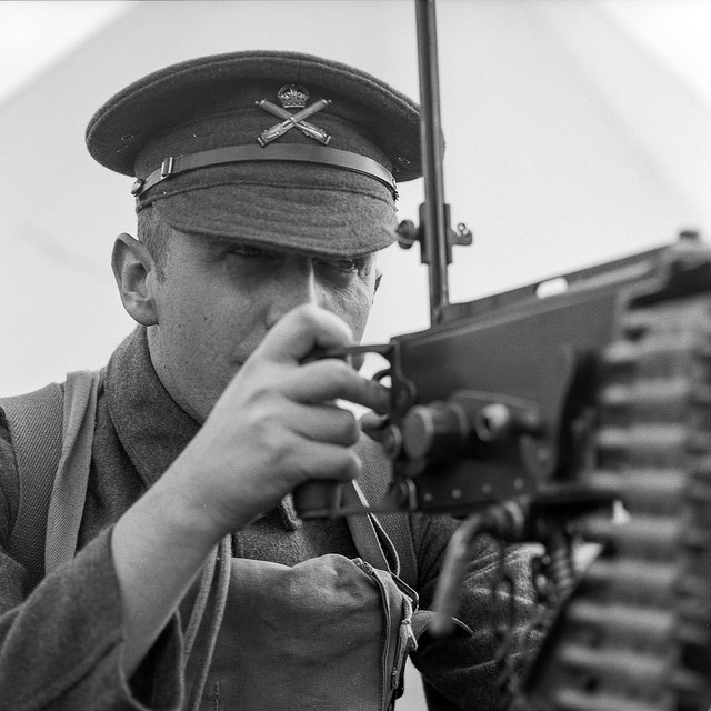 A soldier looks down the sight of a machine gun at the Apedale Valley Railway Tracks to the Trenches even - WW1 photography