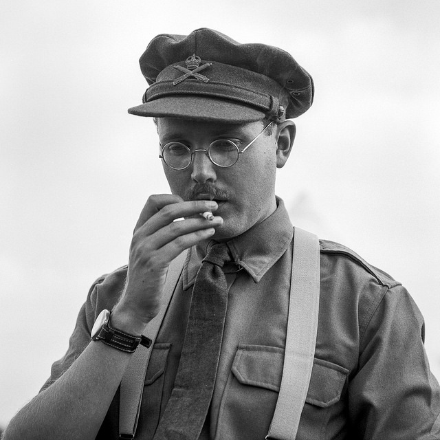 A re-enactor dressed as a WW1 officer smokes a cigarette - WW1 Photography