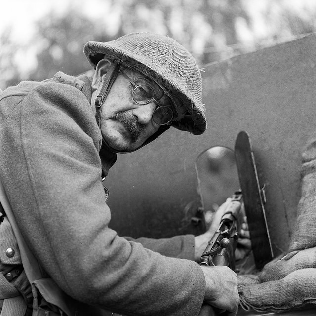 A re-enactor with a rifle in the trenches at the Apedale Valley Light Railway Tracks to the Trenches event. WW1 photography