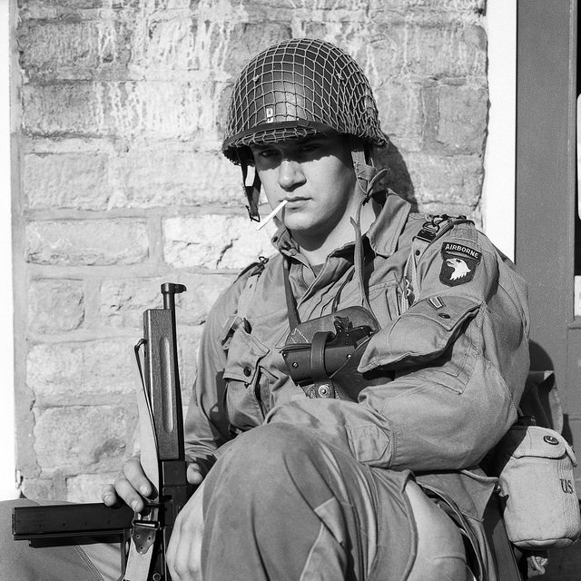 An Airborne soldier rests by a brick wall at the Pickering 1940s weekend event